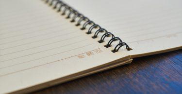 Notizbuch als Trainingstagebuch im Krafttraining